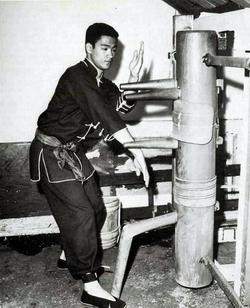 Bruce Lee working on the Wing Chun Wooden Dummy